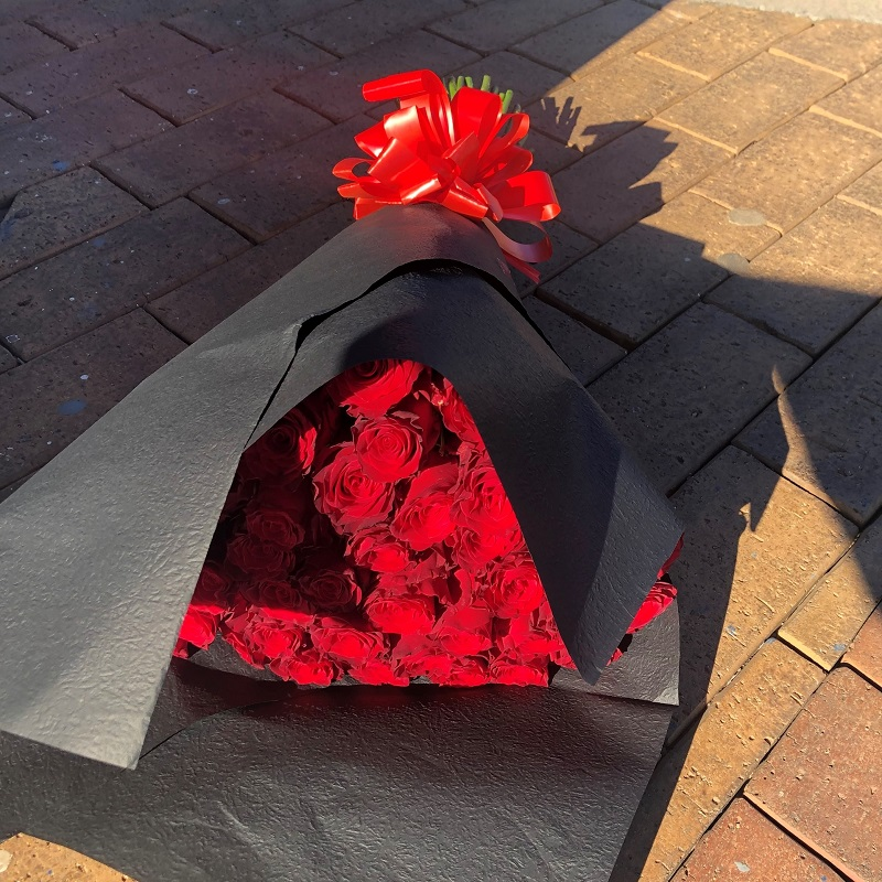 Roses wrapped in black